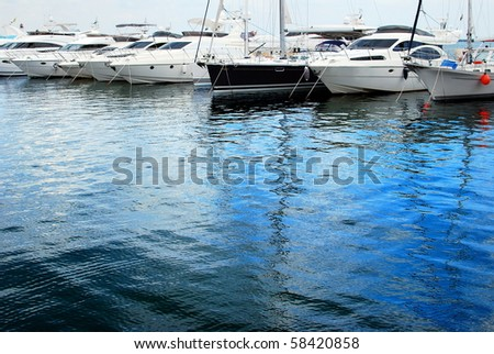 Yachts moored in harbor