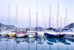 Yachts parking in harbor at sunset, Harbor yacht club in Gocek, Turkey