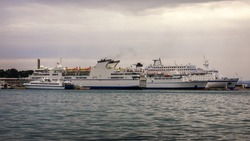Yachts parking in harbor, Harbor in Split, Croatia. Water transport, beautiful vessel in the harbor, summer vacation, active lifestyle, holiday concept. Split, Croatia.