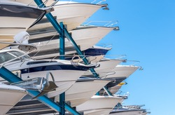 Yachts stored up in dry storage waiting for maintenance