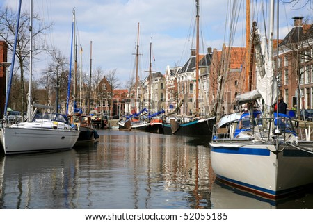 Yachts waiting for opening the drawbridge in Groningen. Channel on the old town. Netherlands .