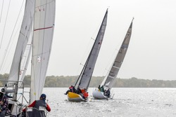Yachtsman aboard a yacht in pursuit of leaders, rear view