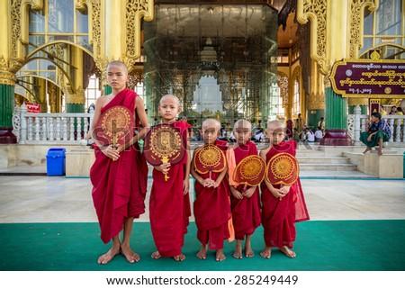 Yagon ,Myanmar - April 13,2014 : Myanmar Novice monk in temple #285249449