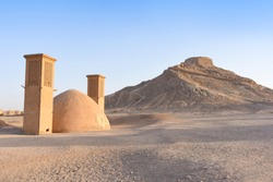 Yakhchal is an ancient cooling building in the form of a dome, at the foot of the Towers of Silence. Iran. Yazd.
