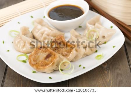 Yaki-Gyoza - Japanese pan-fried dumplings served with a soy based ...