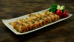 Yakitori Grilled Bacon and Golden Needle Mushroom Wrapped with Sauce teriyaki Sprinkle Spring onion Japanese Food fusion style perfect BBQ Goodtasty Easy dish carved Cucumber parsley and tomatoes