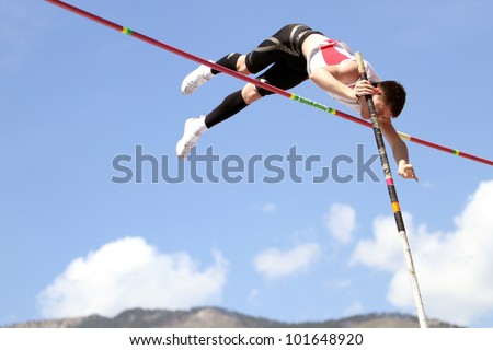 YALTA, UKRAINE - APRIL 25: Haletski Rostislav compete in the pole vault competition for boys age 16-17 on Ukrainian Junior Track and Field Championships on april 25, 2012 - Yalta, Ukraine.