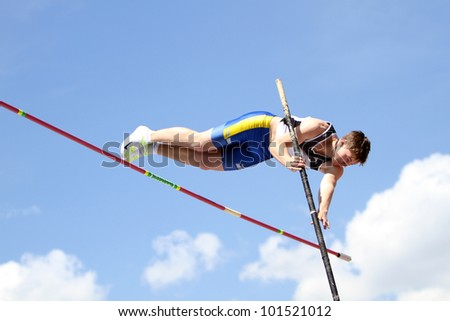 YALTA, UKRAINE - APRIL 25: Kononihin Aleksandr compete in the pole vault competition for boys age 16-17 on Ukrainian Junior Track and Field Championships on april 25, 2012 - Yalta, Ukraine.