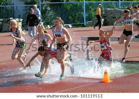 YALTA, UKRAINE - APRIL 27: unidentified girls compete in the 2000 Meter Steeplechase for girls age 16-17 on Ukrainian Junior Track and Field Championships on april 27, 2012 - Yalta, Ukraine.