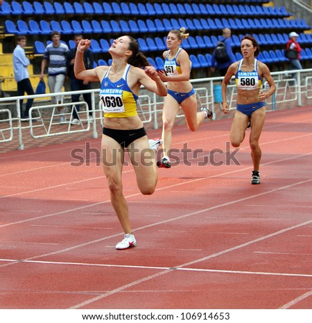 YALTA, UKRAINE - JUNE 01:(L-R) Kolesnichenko Olena, Slusarenko Katerina,  Lebed Anastasia compete in the 400 meters race on Ukrainian Track & Field Championships on June 01, 2012 in Yalta, Ukraine