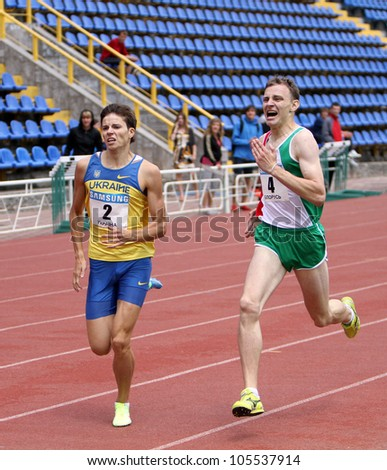 YALTA, UKRAINE - MAY 25: (L-R) Aleksandr Karpenko and Yan Sloma compete in 800 meters race on international athletic meet between UKRAINE, TURKEY and BELARUS on May 25, 2012 in Yalta, Ukraine.