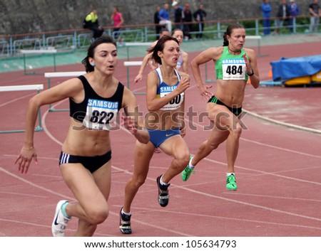 YALTA, UKRAINE, MAY 28: (L-R) Nikonenko Viktoria, Lebed Anastasia, Titimets Anna compete at the 400 meters race on Ukrainian Cup in Athletics, on May 28, 2012 in Yalta, Ukraine .