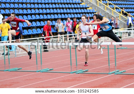 YALTA, UKRAINE - MAY 25: (L-R) Sytnikov Sergei, Kalinin Vitali, Kandymov Maksat  on 110 meters hurdles race on the athletic meet between UKRAINE, TURKEY and BELARUS on May 25, 2012 in Yalta, Ukraine