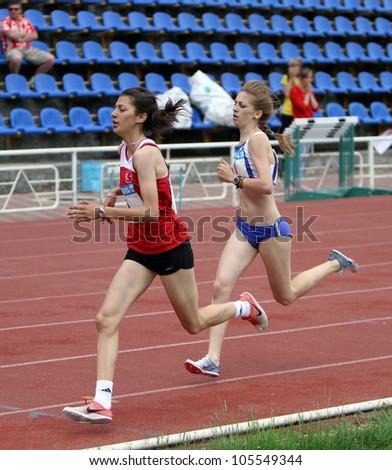 YALTA, UKRAINE - MAY 25: (L-R) Tuna Emine, Tsarik marina compete on the 800 meters race on the international athletic meet between UKRAINE, TURKEY and BELARUS on May 25, 2012 in Yalta, Ukraine.