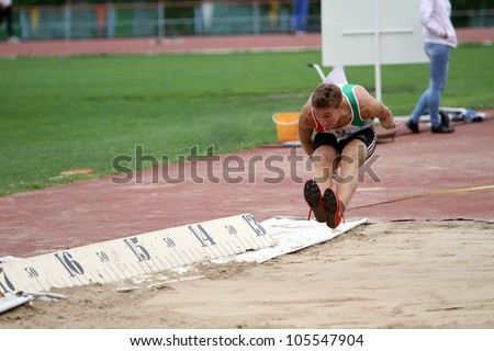 YALTA, UKRAINE - MAY 25: Smal Komstantin competes in the triple jump on the international athletic meet between UKRAINE, TURKEY and BELARUS on May 25, 2012 in Yalta, Ukraine.