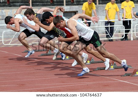 YALTA, UKRAINE - MAY 24: Unidentified athletes at the start of 100 meters dash on the international athletic meet between Ukraine, Turkey, Belarus on May 24, 2012 in Yalta, Ukraine .