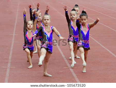 YALTA, UKRAINE - MAY 24: Unidentified girls perform on the opening ceremony of the international athletic meet between Ukraine, Turkey, Belarus on May 24, 2012 in Yalta, Ukraine