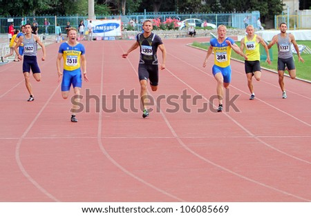 YALTA, UKRAINE - MAY 28: Unidentified men at the 200 meters race on Ukrainian Cup in Athletics on May 28, 2012 in Yalta, Ukraine.