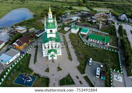 Yalutorovsk, Russia - August 20, 2017: Sretensky cathedral and Sretensky fortress. It is recreated in original form to 350 anniversary of town. Partially burned down in January, 2014 #753491884