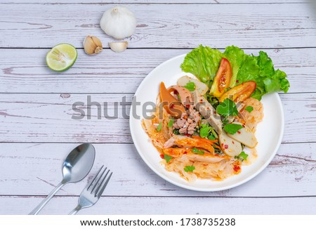 """yam wun sen, Glass noodle spicy salad with Thai pork sausage ,mix vegetables,mushrooms, carrots,onions,minced pork and chilly in Thailand it call """"Yam moo yo"""" Popular and famous food in Thai. Zdjęcia stock ©"""