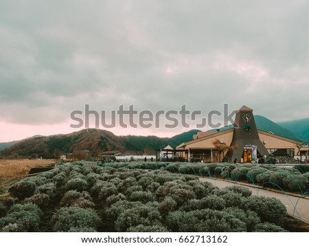 Yamanashi , Kawaguchiko , Japan - December 2016 : people travel at station 22 (Kawaguchiko Natural Living Center) with mountain and cloudly sky background #662713162