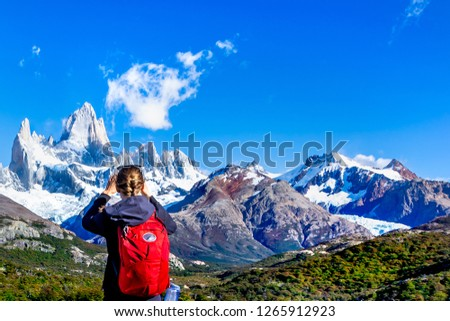 Yang sportive active hiker girl  enjoying the view to Fitz Roy Moutain, Patagonia, El Chalten, trekking to Laguna de Los Tres  - Argentina