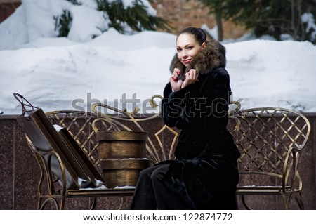 Yang woman gets rest on the winter bench after Christmas shopping.