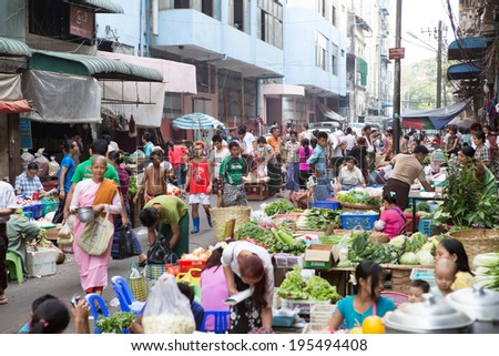 Yangon,Myanmar-April 6, 2014:Trading activities at the downtown Yangon market. This is a local market in the village of Yangon where people come from all over the area to sell fruits,vegetables, etc.