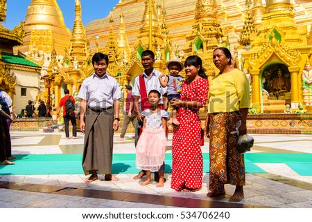 YANGON, MYANMAR - AUG 24, 2016: Unidentified Burmese people in a local temple. 68 per cent of Myanma people belong to Bamar ethnic group #534706240