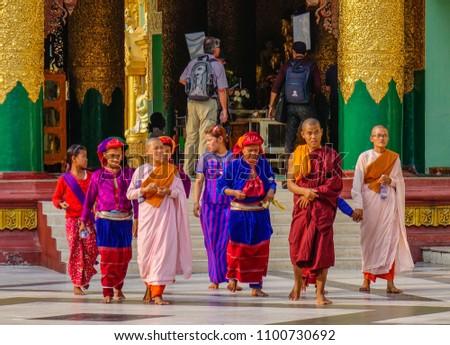 Yangon, Myanmar - Feb 26, 2016. Burmese people visit Shwedagon Pagoda in Yangon, Myanmar. Shwedagon is the most famous landmark of Yangon. #1100730692