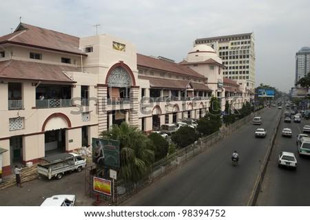 YANGON, MYANMAR - FEB 27: Outside view of Bogyoke Market on February 21, 2012 in Yangon, Myanmar. Bogyoke Market was built in 1926 and was formerly known as Scott Market.