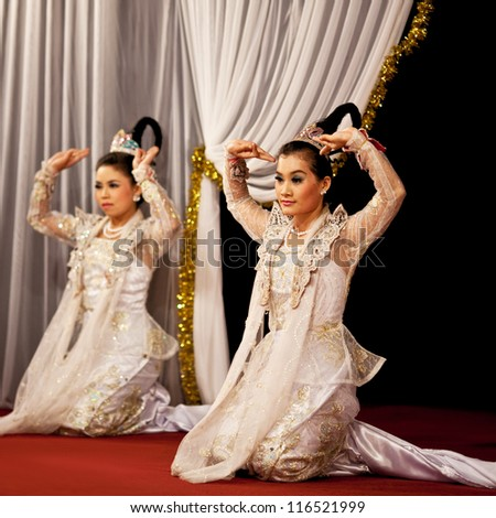 YANGON, MYANMAR - JANUARY 25: Two unidentified dancers perform traditional classical Burmese dance in honor of Karen New Year on January 25, 2011 in Yangon, Myanmar