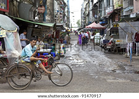 YANGON, MYANMAR- OCT 16: A typical street of vendors in downtown Yangon, Myanmar on October 16, 2011. Yangon was founded as Dagon in the early 11th century (c. 1028–1043) by the Mon People