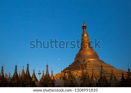 Yangon, Myanmar view of Shwedagon Pagoda at sunset . copyspace  Image  . copyspace  Image