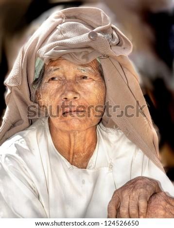 YANGOON, MYANMAR - NOVEMBER 9 ; An unidentified older woman is posing on Nov.9 2011, Yangoon, Myanmar. The life expectancy of woman in myanmar is 64 years .