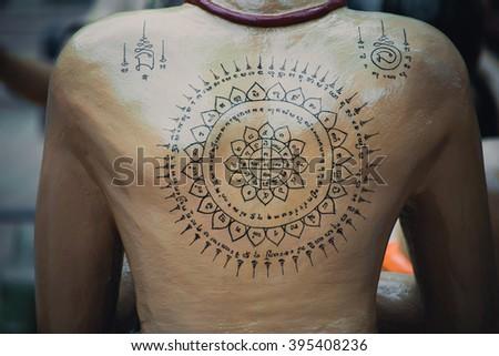 Yantra tattoo or sak yant thai sacred tattoo stock photo for Sak yant tattoo rules