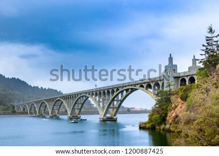 Yaquina Bay Bridge in Newport, an Oregon architectural icon. The bridge crosses Yaquina Bay estuary, thus its name.
