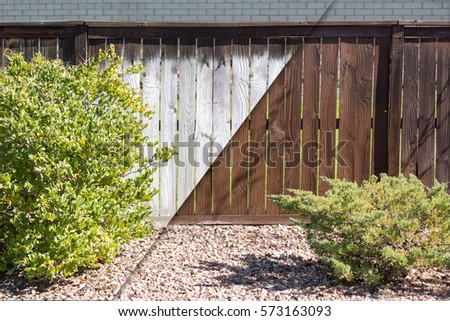 Yard Fence Before and After Solid Paint Stain Application.