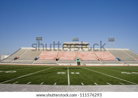Yard lines on American football field in stadium