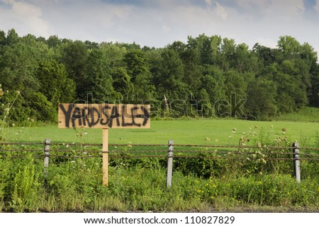 yard sale sign on country road