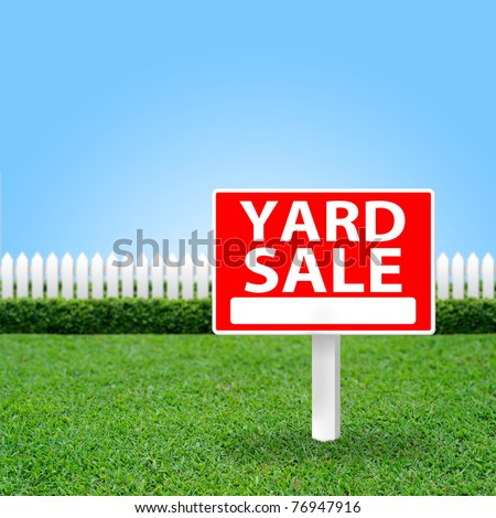 Yard Sale sign on grass field.