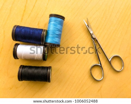 Yarn and scissors on wooden table #1006052488