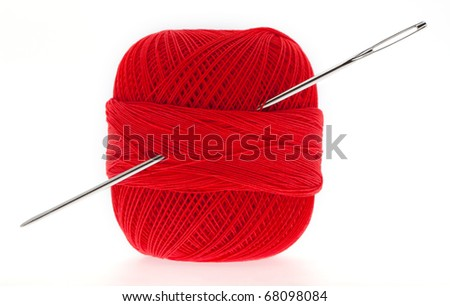 Yarn with needle in front of white background