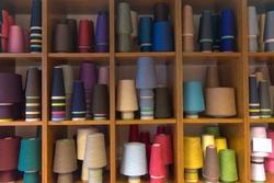 Yarn wool bobbins in a shop of milan
