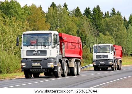 YAROSLAVL REGION, RUSSIA - AUGUST 26, 2011: White dump trucks MAN TGA at the interurban freeway.