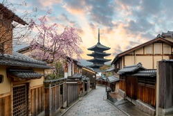 Yasaka Pagoda and Sannen Zaka Street with cherry blossom in the Morning, Kyoto, Japan. Landscape and culture travel, or historical building and sightseeing concept