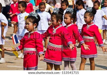 YASOTHON,THAILAND-F EB 17: unidentified Thai children in native dress dance in \
