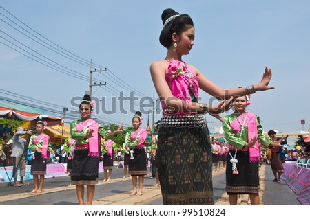 YASOTHORN,THAI-MAY 5:Unidentified dancers perform at the Thai Dance in Rocket festival 'Boon Bang Fai' The celebration for plentiful rains during the rice plant season,on May 5,2010 Yasothorn,Thailand
