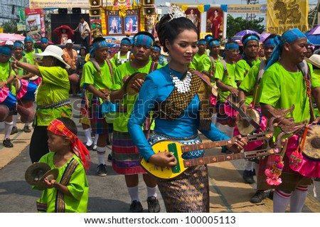 YASOTHORN,THAI-MAY 5:Unidentified local musicians perform at the parade in Rocket festival 'Boon Bang Fai' The celebration for plentiful rains during the rice plant season,on May 5,2010 Yasothorn,Thai