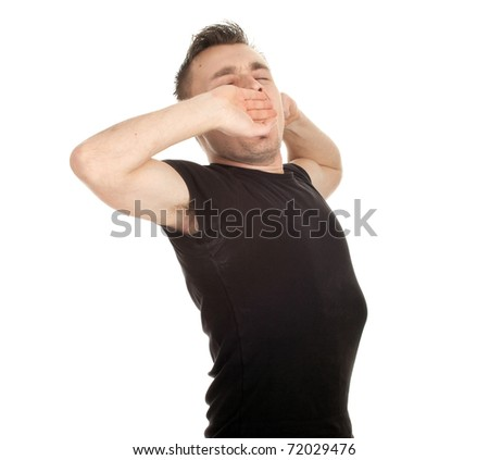 yawning and stretching young man in black casual shirt